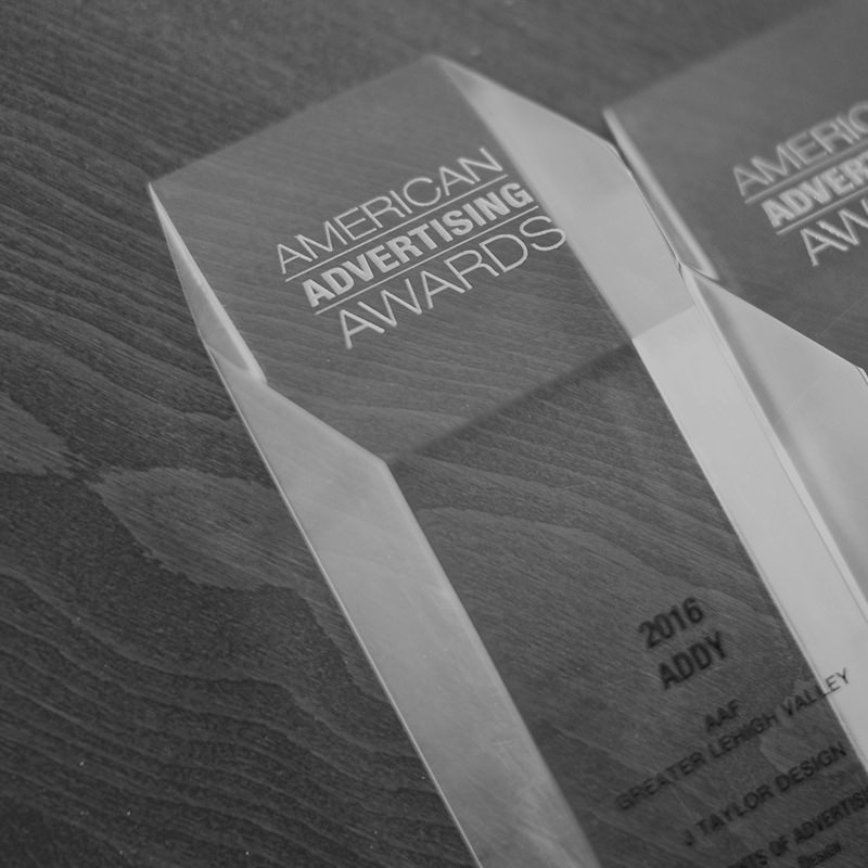 Gold Addy Awards for Logo and Website Design